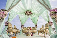 Such a gorgeous looking wedding mandap setup with drapes and florals!