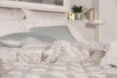 Layered luxury bed linens and cushions