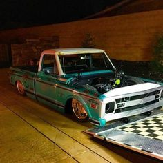 lowfastfamous: Hot Wheels - Yeah @superflysteiny new build Cheap Trick looking the business getting loaded up! #chevrolet #gmc #c10 #AirSuspension #bagged #raked #stance #layframe #hotrod #streetrod #streettruck #streetmachine #truckporn #carporn #lowfastfamous