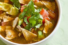If you like your Mexican food with extra lime, this easy vegetarian and vegan tortilla soup recipe is for you. It's a bit on the thin side, so it makes a good starter soup or a light meal. For something a bit more hearty, add some black beans, hominy, or even a meat substitute such as TVP.