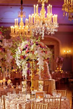 Tall Golden Candelabras Dripped with Pink, White + Lavender Roses, White Phalaenopsis Orchids, Hydrangeas and Stock | Wazzan Floral Design https://www.theknot.com/marketplace/wazzan-floral-design-detroit-mi-560224 | Jess + Nate Studios https://www.theknot.com/marketplace/jess-+-nate-studios-ann-arbor-mi-535965