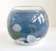 Peach Mango Scented Ocean Blue Gel Seascape Candle with a Pagoda in Glass Bowl Gel Candles, Scented Candles, Clear Glass, Wine Glass, Blue Gel, Beautiful Candles, Snow Globes, Mango, Peach