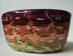Small glass bowl covered in polymer clay. www.beadsbymeforyou.com