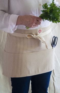 Adorable Ticking Stripe Utility aprons from Raw Materials Design. http://www.rawmaterialsdesign.com/ticking.html