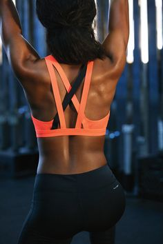 Try this strappy cardio bra for extra support and comfort. Black leggings complete this stylish gym look.