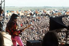 Jimi Hendrix performs at a pop festival on the Baltic Sea island of Fehmarn.