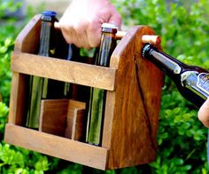 Home Brew Beer Bottle Carrier.  Hand crafted from rustic, knotted, raised grain pine and finished off with a stunning copper handle, the Home Brew Six Pack Bottle Carrier is an incredible accessory for beer drinkers