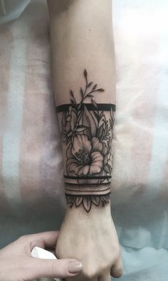 50 Meaningful Wrist Bracelet Floral Tattoo Designs You Would Love To Have - Page 32 of 50 - Cute Hostess For Modern Women Arm Band Tattoo For Women, Cover Up Tattoos For Women, Wrist Band Tattoo, Wrist Tattoo Cover Up, Wrist Bracelet Tattoo, Tattoos For Women Flowers, Flower Wrist Tattoos, Arm Cuff Tattoo, Floral Tattoo Design