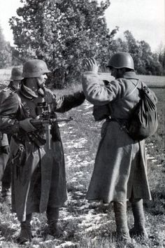 German soldiers searching a Red Army POW. WW II