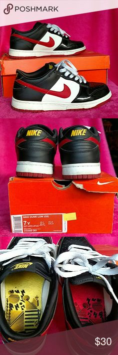 Nike Dunk Lows 7Y, Womens 9 Pre loved Nike Dunk Lows. Black/white leather mixed with black patent leather around the toe box. Yellow nike on back and on tongue. This is 7 Y. Woman's 9 but dunks tend to fit eider could fit up to 9-10 Nike Shoes Sneakers