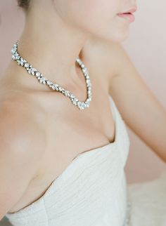 Marquise and round cut Swarovski crystals create this beautiful, classic necklace. Rhodium plated.
