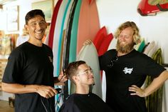 """Malikai Michell, """"Jimbo"""" and Thomas Bexon at their store in Noosaville, which sells haircuts, shaves, surfboards, clothing, bicycles, pomade and shampoo. (Image: Jon Coghill/ABC)"""