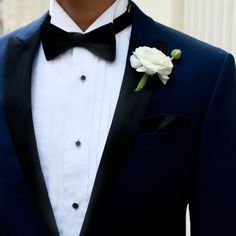 Clean, classic white boutonniere matches perfectly with this Calvin Klein tuxedo.