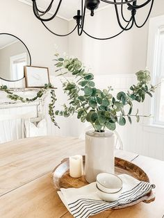 Ways to decorate with eucalyptus this winter and a round up of all my favorite faux eucalyptus stems, garland and wreaths. Table Centerpieces For Home, Dining Room Table Centerpieces, Decoration Table, Kitchen Table Decorations, Dinning Room Table Decor, Deco Table, Dining Table Decor Everyday, Accent Table Decor, Round Kitchen