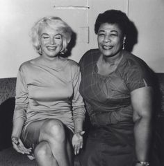 Marilyn Monroe and Ella Fitzgerald. Would have been a great pic if Marilyn's eyes were open.. Cameras. Lol