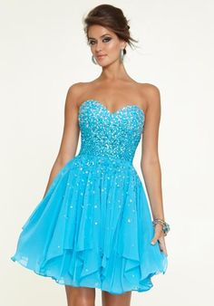 Aqua Blue Mori Lee Sticks & Stones Sweetheart Neckline Dress 9308. A sweetheart neckline and form fitted beaded bodice, with a layered chiffon skirt. So cute for a winter wonderland sweet 16 birthday party!