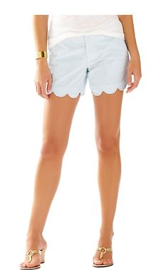 The 5 inch shorts are a must have Lilly staple. This blue scalloped seersucker short is perfect for your favorite tanks, tees and Anna Maria button downs.