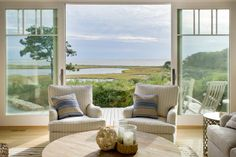 Beautiful finishes mixed with a spectacular view make this summer home on Martha's Vineyard a dreamy destination. Slide back the glass doors and step out onto the deck to take in the unencumbered seascape.