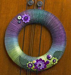 The prettiest spring yarn wreath. Make it fast with a thicker yarn. - diy