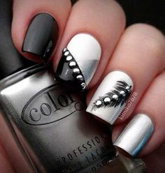 black, white and sliver with strips, jewels and a feather nail art design