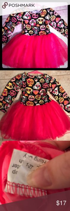 NWOT Boutique Candy Skull Tulle Dress This Lily Bow Peep Boutique dress is the perfect addition to any little princess' closet! The top is stretchy with black background and multi-colored candy skulls, along with a gorgeous hot pink tulle skirt! Smoke free home; NWOT. Lily Bow Peep Dresses Casual