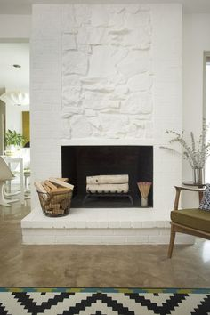 White fireplace // At home with Brooke Fish // A Beautiful Mess Painted Stone Fireplace, Fireplace Redo, White Fireplace, Brick Fireplace, Fireplace Design, Fireplace Makeovers, Stone Fireplaces, Modern Fireplace, Fireplace Ideas