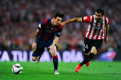 Lionel Messi of FC Barcelona competes for the ball with Mikel Balenziaga of Athletic Club during the Copa del Rey Final match between FC Barcelona and Athletic Club at Camp Nou on May 30, 2015 in Barcelona, Catalonia.