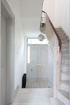 Simple white and grey hallway photo location: wray crescent Hallway Decorating, Interior Decorating, Grey Hallway, Entry Hallway, Entrance Hall, Victorian Terrace House, Victorian Hallway, Grey Doors, My New Room
