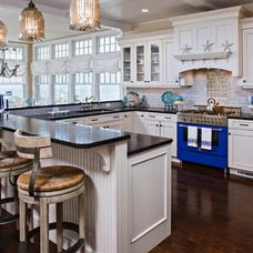 Beach Style Kitchen with Blue Star Stove and white cabinets (minus the raised bar on wrap around island)