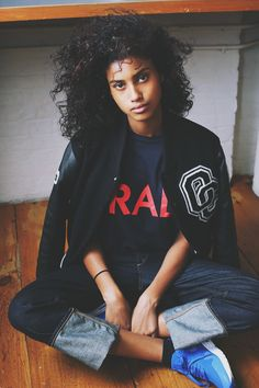 """Imaan Hammam, on the floor of her modeling agency, wears a """"roots""""-style jean with a selvage hem and a BIG cuff.  Rag & Bone/JEAN the vintage boyfriend jeans, $225 shopbop.com  Opening Ceremony jacket, 6397 tee, Nike sneakers"""