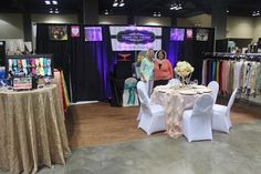Wedding professionals in their vendor booth. See more from the Summer 2015 Memphis Pink Bridal Show®! | The Pink Bride® www.thepinkbride.com