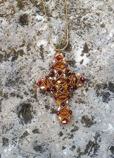 Check out Sylvia pendant Beading tutorial.Pattern.PDF file containing instructions for making the Crystal Cross Pendant, not the pendant itself. on emeliebeads