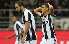 Paulo Dybala (R) of Juventus FC reacts to a missed chance during the Serie A match between AC Milan and Juventus FC at Stadio Giuseppe Meazza on October 22, 2016 in Milan, Italy.