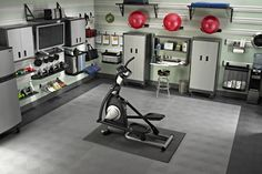 Garage gym - like how they mounted gym storage on the walls and kept an open feeling on the floors. Also like how TV and components are mounted