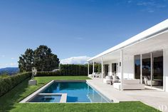 A Roy Lichtenstein sculpture sits poolside at the California home of Elton John and David Furnish.