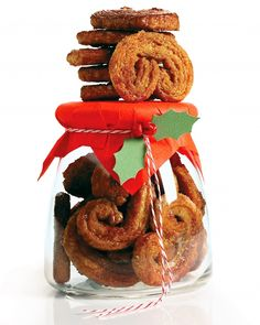 Gingersnap Palmiers - Palmiers, sometimes called palm leaves, are made with puff pastry folded several times, then sliced, to create a distinctive heart-shaped coil design. Ginger syrup and spiced sugar make these crisp French cookies festive and fragrant.
