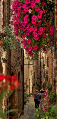 Strolling on the beautiful streets of Spello in Umbria, Italy.  Almost missed the people walking down the alley.