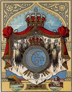 "https://flic.kr/p/GSdUk | Grand State Coat of Arms of the Khedivat of Egypt (1867 - 1914) | These arms where assumed during the reign of Khedive Ismail Pacha the Magnificent when Egypt was elevated to a Khedivate.  The blazon, in the language of heraldry is: ""Azure a Decrescent and three Five Pointed Stars Argent."" - meaning Blue with a crescent with horns to the right and three stars, all silver or white.  The six tughs in saltire indicate the rank of Khedive. This image is courte..."