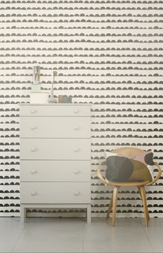 This wallpaper is perfect for a child's space - modern & fresh, whimsical but understated so the accessories can be changed out with the little one's growth & quickly changing style - half moon pattern ferm living