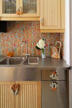 Kitchen tile backsplash (and pitcher) of Brooklyn ceramic artist Nadeige Choplet ~ Awesome!