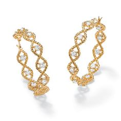 You\'ll ignite sparks from every angle whenever you wear this pair of cubic zirconia inside-out twisted hoop earrings. 3Price - $39-uWf7xAM4