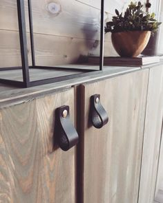 This IVAR shelving unit is totally on-trend with leather pulls.