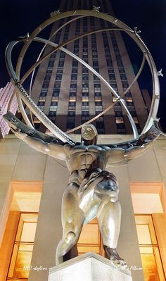 Atlas statue, Manhattan in New York City -   a symbol of wealthy New York on 5th Avenue- one of the most expensive streets in the world ...