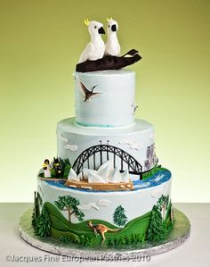 Australia themed wedding cake with cockatoo toppers