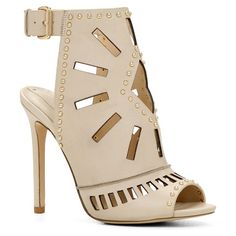 Uneasien sandals by ALDO. These oh-so unique ankle-wrap pumps will definitely make heads turn! - Caged heel. - Single sole....