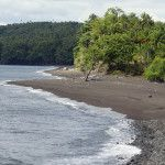 A black sand beach at Tolire Kecil in Pulau Ternate in the Maluku Archipelago