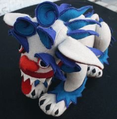Google Image Result for http://www.tibetcraft.com/files/imagecache/preview/files/product_images/small-snowlion.gif