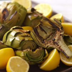 Grilled Artichokes  2 lemons 4 large artichokes, (3-3 1/2 pounds total) 1 tablespoon extra-virgin olive oil 1/4 teaspoon salt Freshly ground pepper, to taste