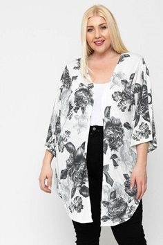 Made In U.S.A 1XL.2XL.3XL Floral print, long body cardigan featuring side slits, and kimono style sleeves. 33% Rayon 63% Polyester 3% Spandex Black/Floral POL Floral Print, Long Body Cardigan Floral Cardigan, Floral Kimono, Black Cardigan, Long Cardigan, Floral Fabric, Kimono Top, Look Plus Size, Plus Size Tops, Cardigan Fashion