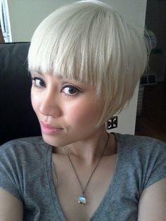 Short platinum hair with heavy bangs-- this is the cut I want... minus platinum!!!